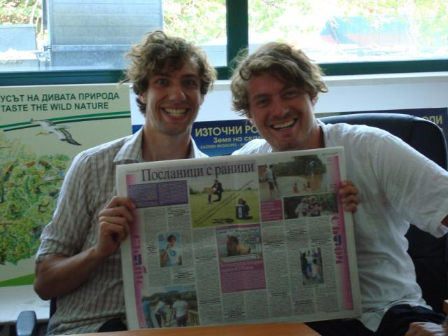 Dutch Postcode Lottery Charity Ambassadors Rikus and Sijmen show a publication about them and their visit to the Eastern Rhodopes in a Bulgarian newspaper (Photo: Iva Tontcheva)