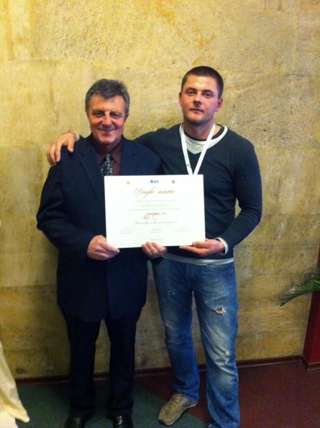 Yonko Todorov (left) and his son Tihomir with charter for their wine made of organic grapes